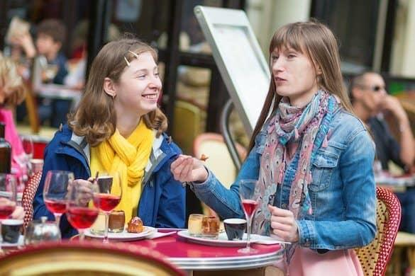 Beautiful girls in a Parisian cafe.