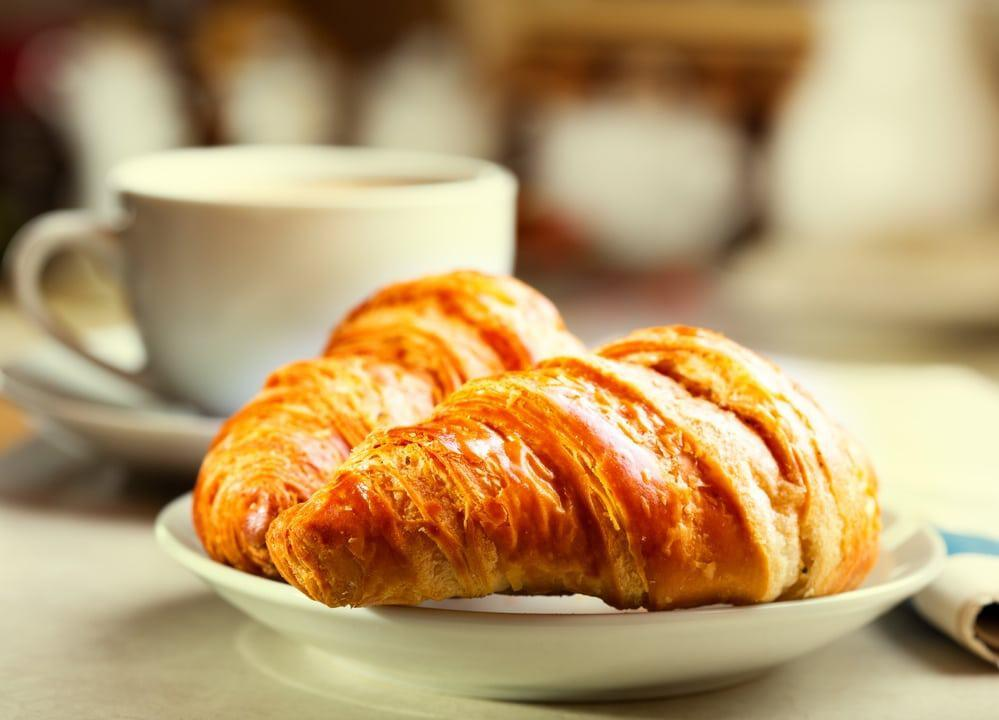 the typical French breakfast: croissants and coffee,