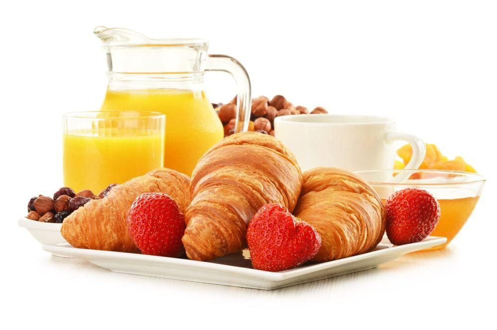 French breakfast plate with croissants, berries and orange juice