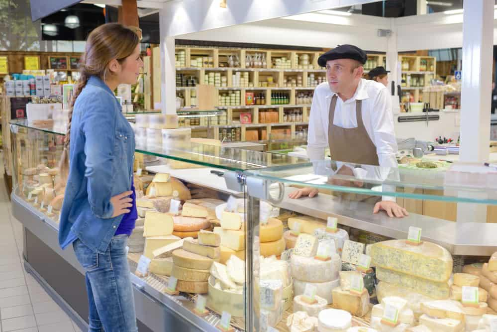 woman buying French cheese