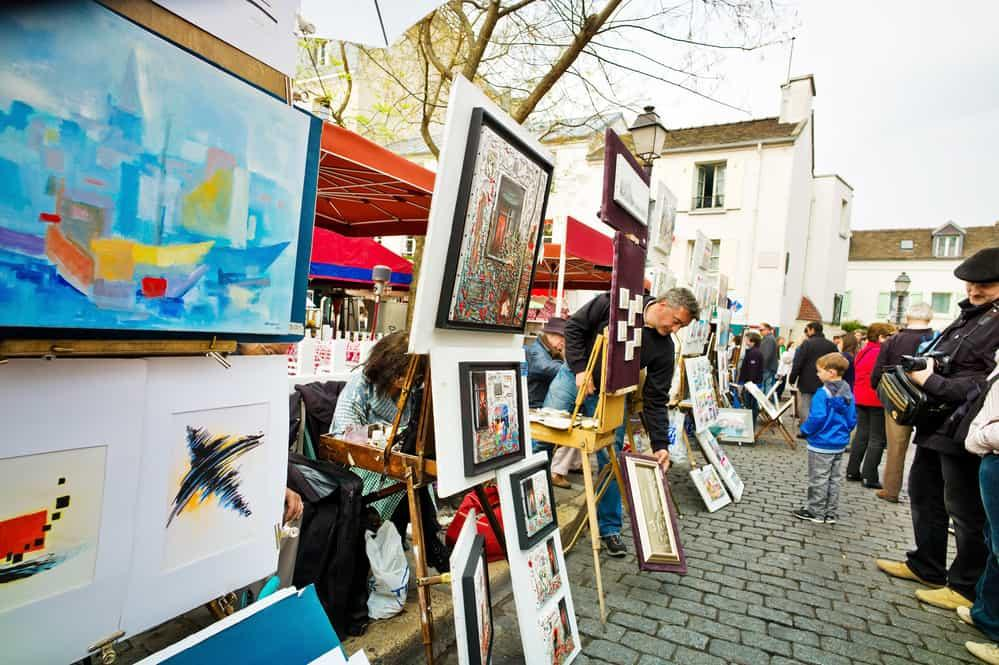 painters put their pictures on the place du tertre in paris, france.
