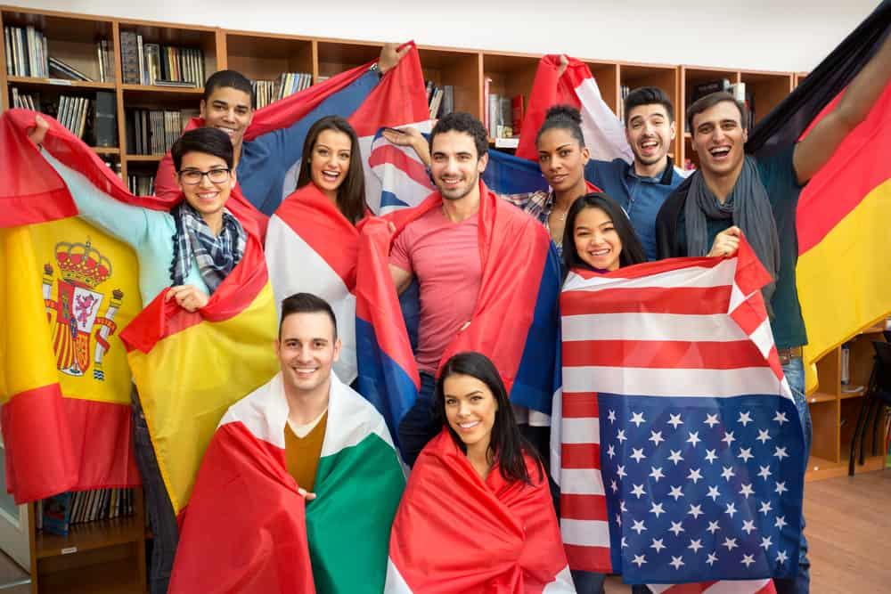 young people participating in language exchange and holding flags
