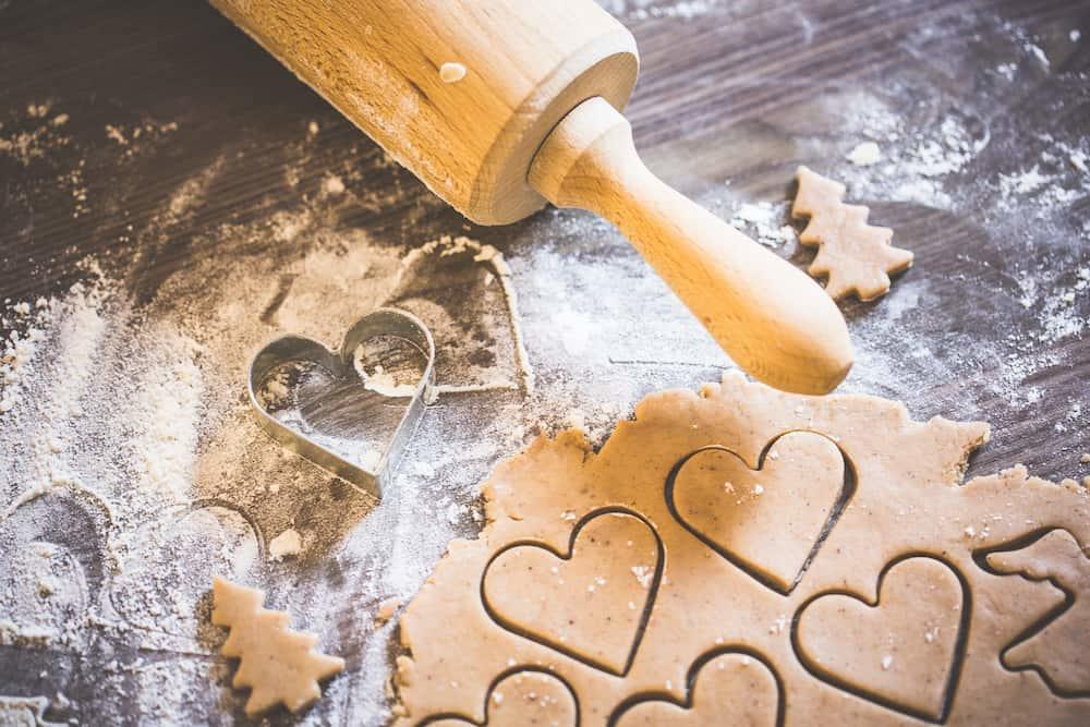 Cooking Christmas sweets in shape of hearts.