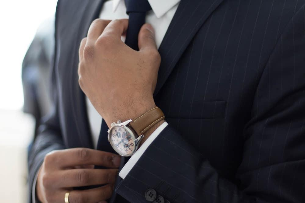 Man wearing watch with suit