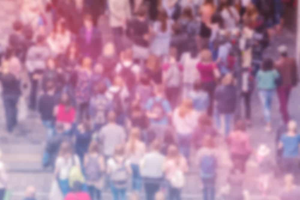 A blurred image of a crowd.