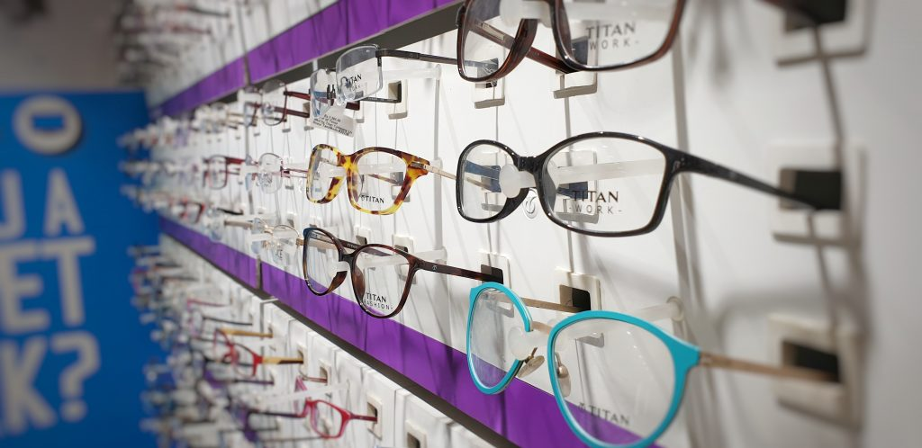 Glasses on a display wall at an optician's.