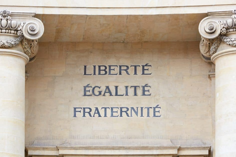 "A carved inscription on a neoclassical building's facade reads ""Liberté, Égalité, Fraternité"". The style of carving and the stone building seem to date to the late 18th or early- to mid -19th century."
