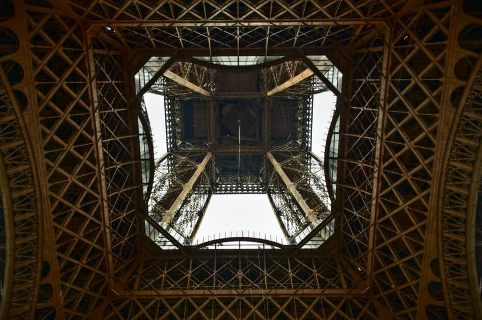 The view looking up from the center of the Eiffel Tower.