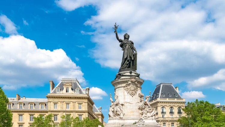 The large, famous bronze statue of Marianne at the center of the Place de la Republique in Paris.